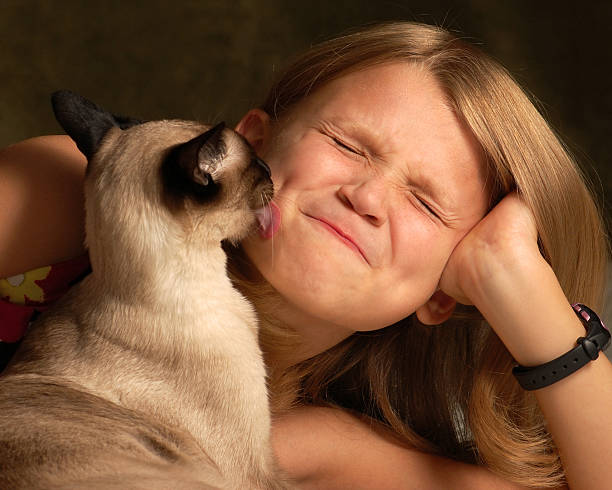 WHY DOES MY CAT LICK MY FACE?